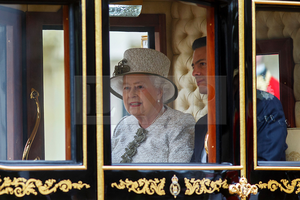 © Licensed to London News Pictures. 03/03/2015. LONDON, UK. The Queen and President of Mexico Enrique Peña Nieto ride in a state carriage on their way to Buckingham Palace following a Ceremonial Welcome during Mexican President's state visit in central London on Tuesday, 3 March 2015. Photo credit : Tolga Akmen/LNP