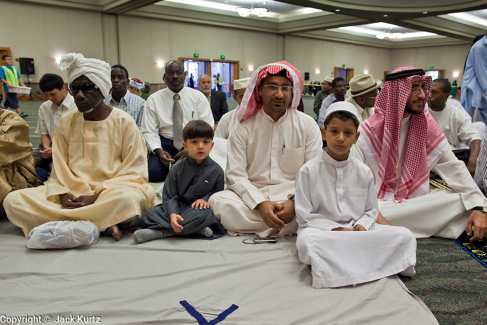 """Sept. 10 - GLENDALE, AZ:  Muslim men gather in the Glendale Civic Center in Glendale, before Eid ul-Fitr services. Muslims from the Phoenix area celebrated Eid ul-Fitr, the end of Ramadan, at the Glendale Civic Center in Glendale, AZ, a suburb of Phoenix. Eid ul-Fitr, often abbreviated to Eid, is the Muslim holiday that marks the end of Ramadan, the Islamic holy month of fasting. Eid is an Arabic word meaning """"festivity"""", while Fitr means """"conclusion of the fast""""; and so the holiday symbolizes the celebration of the conclusion of the month of fasting from dawn to sunset during the entire month of Ramadan. The first day of Eid, therefore, is the first day of the month Shawwal that comes after Ramadan.  Photo by Jack Kurtz"""