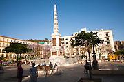 People enjoying a sunny spring afternoon in Plaza de la Merced, Malaga, Spain