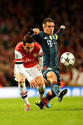 19.02.2014, Emirates Stadion, London, ENG, UEFA CL, FC Arsenal vs FC Bayern Muenchen, Achtelfinale, im Bild Arsenal's Santi Cazorla and Bayern Munich's Philipp Lahm compete for the ball // Arsenal's Santi Cazorla and Bayern Munich's Philipp Lahm compete for the ball during the UEFA Champions League Round of 16 match between FC Arsenal and FC Bayern Munich at the Emirates Stadion in London, Great Britain on 2014/02/19. EXPA Pictures © 2014, PhotoCredit: EXPA/ Mitchell Gunn<br /> <br /> *****ATTENTION - OUT of GBR*****