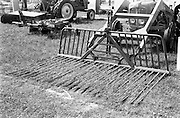 """29/04/1962<br /> 04/29/1962<br /> 29 April 1962<br /> Farm machinery at the R.D.S. Spring Show, Ballsbridge Dublin, feature with Julian Bayley for Farming Express. Image shows a """"Silosvans"""" buckrake."""