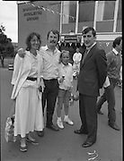 """Guinness Family Day At The Iveagh Gardens. (R83)..1988..02.07.1988..07.02.1988..2nd  July 1988..The family fun day for Guinness employees and their families took place at the Iveagh Gardens today. Top at the bill at the event were """"The Dubliners"""" who treated the crowd to a performance of all their hits. Ireland's penalty hero from Euro 88, Packie Bonner, was on hand to sign autographs for the fans...Gay Mitchell TD is pictured chatting with the O'Neill family at the Guinness Family Day event at Iveagh Gardens."""