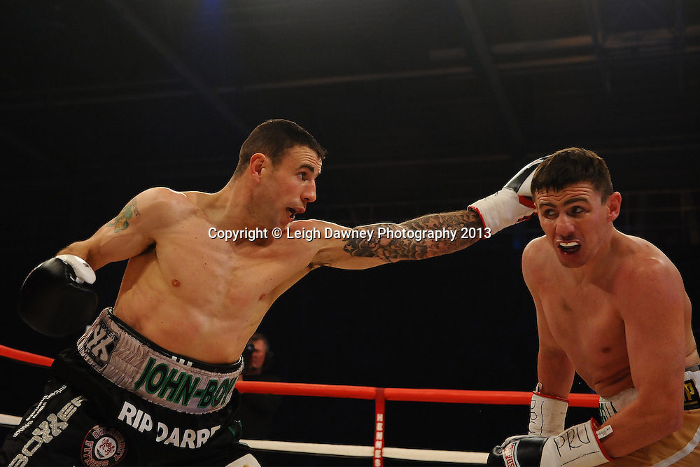 Peter McDonagh (right) defeats John Hutchinson to claim the Vacant Irish Light Middleweight Title on 15th March 2014 at the Rivermead Leisure Centre, Reading, Berkshire. Promoted by Hennessy Sports. © Leigh Dawney Photography 2014.
