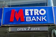 Signs on Metro Bank building, Regent Street, Swindon, Wiltshire, England, UK open 7 days