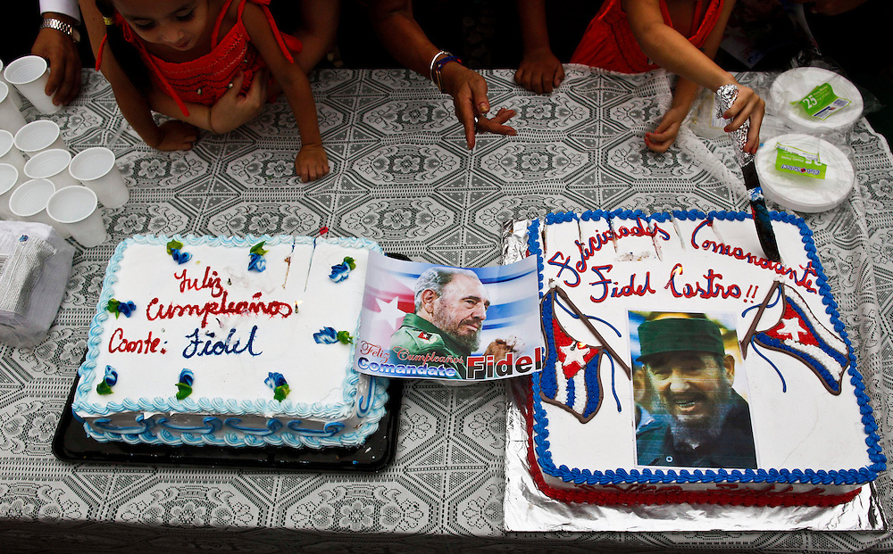 People attends a birthday celebration of the Cuba's leader Fidel Castro at a Cuba square in Managua, Nicaragua, Friday, Aug. 12, 2011. Supporters of the rulling Sandisnita party , cuban residents and admirers of ailing Fidel Castro celebrate his 85th birthday. Castro will turn 85 Saturday.