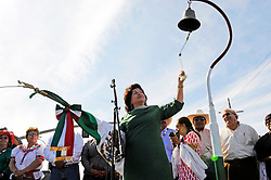 "Honorary Consul Blanca Estela Zarazua rings a replica of Father Miguel Hidalgo's church bell, representing the beginning of the Mexican revolution against Spain more than 200 years ago. ""El Grito,"" or ""The Cry of Independence"" followed the ringing of the bell, with Sunday's crowds along East Alisal in Salinas shouting ""Viva Mexico."""