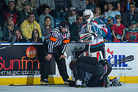 KELOWNA, CANADA - APRIL 30: Referee Reagan Vetter stands beside Michael Herringer #30 and athletic therapist Scott Hoyer as he attends to Devante Stephens #21 of the Kelowna Rockets after a hit from behind against the Seattle Thunderbirds on April 30, 2017 at Prospera Place in Kelowna, British Columbia, Canada.  (Photo by Marissa Baecker/Shoot the Breeze)  *** Local Caption ***