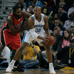 30 January 2009: New Orleans Hornets forward David West (30) is defended by Golden State Warriors forward Ronny Turiaf (21) during a 91-87 loss by the New Orleans Hornets to Golden State Warriors at the New Orleans Arena in New Orleans, LA.