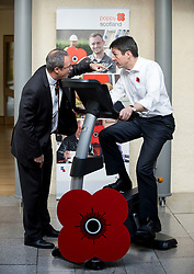 MSP's and staff from the Scottish Parliament hope to cycle the equivalent distance from Edinburgh to Glasgow to raise awareness for Poppy Scotland.<br /> <br />  Pictured: Scottish Parliament Presiding Officer Ken MacIntosh tests out the bike at the start of the challenge watched by Poppy Scotland Chief Executive Mark Bibbey.<br /> <br /> &copy; Dave Johnston/ EEm