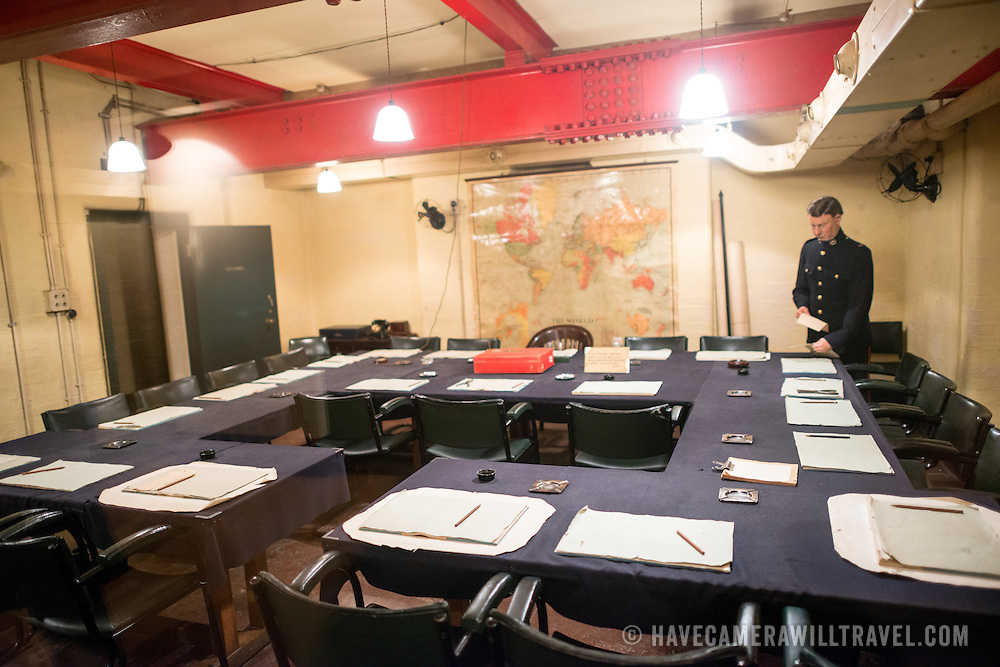 The main Cabinet War Room at the Churchill War Rooms in London. The museum, one of five branches of the Imerial War Museums, preserves the World War II underground command bunker used by British Prime Minister Winston Churchill. Its cramped quarters were constructed from a converting a storage basement in the Treasury Building in Whitehall, London. Being underground, and under an unusually sturdy building, the Cabinet War Rooms were afforded some protection from the bombs falling above during the Blitz.