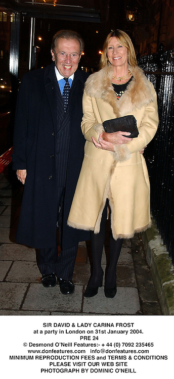 SIR DAVID & LADY CARINA FROST at a party in London on 31st January 2004.<br /> PRE 24