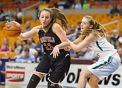 Bluefield center Jia Coppola (11) drives towards the basket against Wyoming East during a first round game at the Charleston Civic Center.