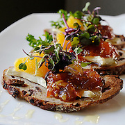 French Brie on cranberry walnut toast with tomato marmalade, amaretto honey and micro basil at Abigail's Grille and Wine Bar, Conn., Saturday, Feb. 20, 2016. (Jessica Hill for the New York Times)