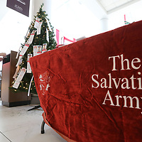"""Katrina Patty begins to hang """"Angels"""" on the Salvation Army Angel Tree at The Mall at Barnes Crossing Monday as they kick off the Christmas season for needy children."""