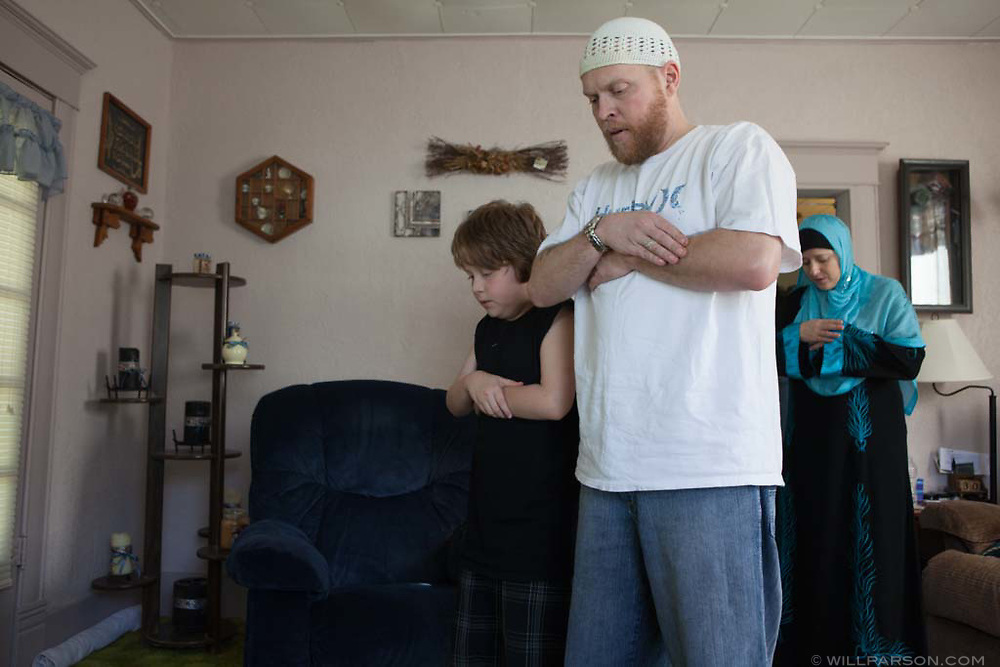 "Abdul-Hakim, Misty and Khalil pray in their home in Parsons, Kansas on November 5, 2010. ""Basically I teach (Khalil) Islam as much as I can, and I encourage that practice, but once he hits a certain age and moves out of the house, it's totally his choice,"" Abdul-Hakim said."