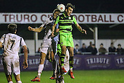 Forest Green Rovers Christian Doidge(9) jumps to head the ball during the FA Trophy match between Truro City and Forest Green Rovers at Treyew Road, Truro, United Kingdom on 13 December 2016. Photo by Shane Healey.