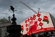 """The Cocoa-Cola Christmas Santa ad appears on the digital screens that overlook Piccadilly Circus, on 22nd November 2019, in Westminster, London, England. Eros aka 'The Shaftesbury Memorial Fountain' is located at the southeastern side of Piccadilly Circus in London, United Kingdom. Moved after World War II from its original position in the centre, it was erected in 1892–1893 to commemorate the philanthropic works of Lord Shaftesbury, who was a famous Victorian politician and philanthropist. The monument is surmounted by Alfred Gilbert's winged nude statue generally, though mistakenly, known as Eros. This has been called """"London's most famous work of sculpture."""""""