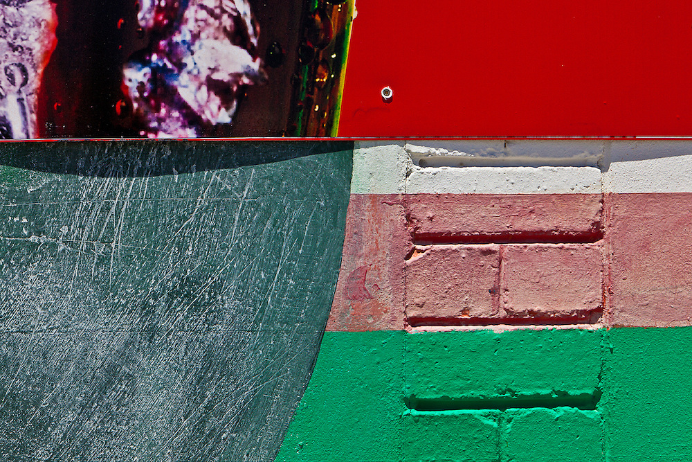 Tight in image of a attention grabbing masonry wall on a market in Namibia, Africa.
