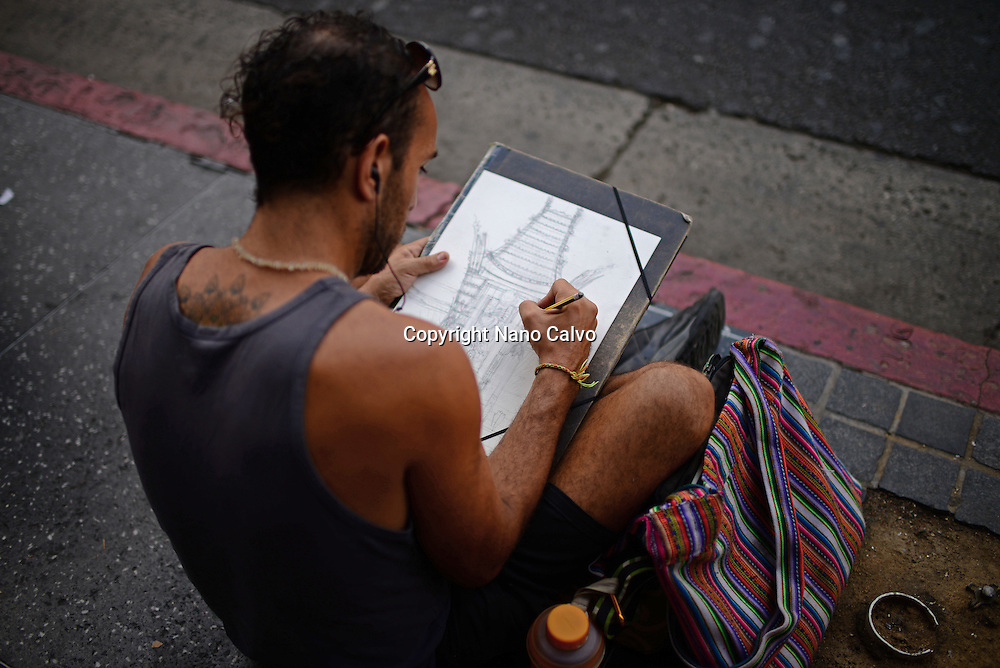 Street artist drawing Grauman's Chinese Theatre in Hollywood Boulevard.