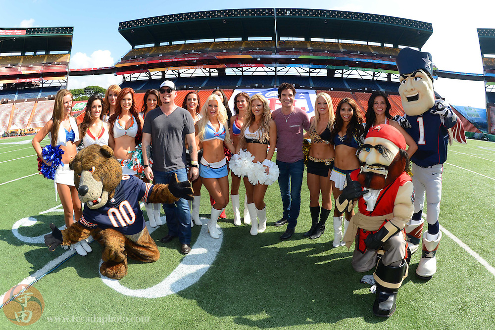 January 26, 2013; Honolulu, HI, USA; NFL cheerleaders and mascots pose for a photo with musical group Train band members Jimmy Stafford (standing, six from left) and Pat Monahan (standing, fifth from right) on Ohana Day at the 2013 Pro Bowl.