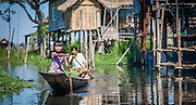 Mother and daughter on a boat in Inle Lake (Myanmar)