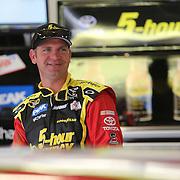 Driver Clint Bowyer is seen near the garage area during the 56th Annual NASCAR Daytona 500 practice session at Daytona International Speedway on Saturday, February 22, 2014 in Daytona Beach, Florida.  (AP Photo/Alex Menendez)