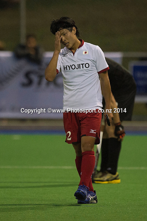 Shunya Miyazaki of Japan stands dejected after their loss during the Black Sticks Men v Japan international hockey match at the Coastlands Kapiti Sports Turf in Paraparaumu on Friday the 21st of November 2014. Photo by Marty Melville/www.Photosport.co.nz