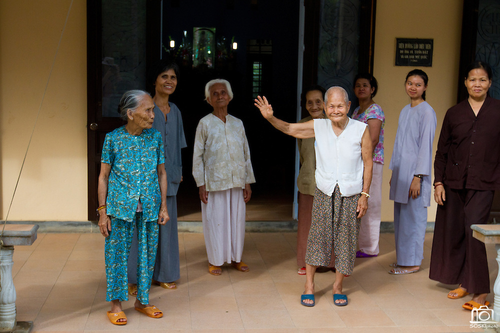 At 92 years of age, Huong Phung is the heart of happiness at the Chua Dieu Vien Pagoda's abandoned elder shelter.  Here she waves me off as others look on.  Photo by Stan Olszewski/SOSKIphoto