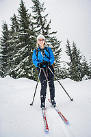 Portrait of a 40's woman on cross country skiis.  Cabin Creek Snow Park, Washington Cascades, USA.