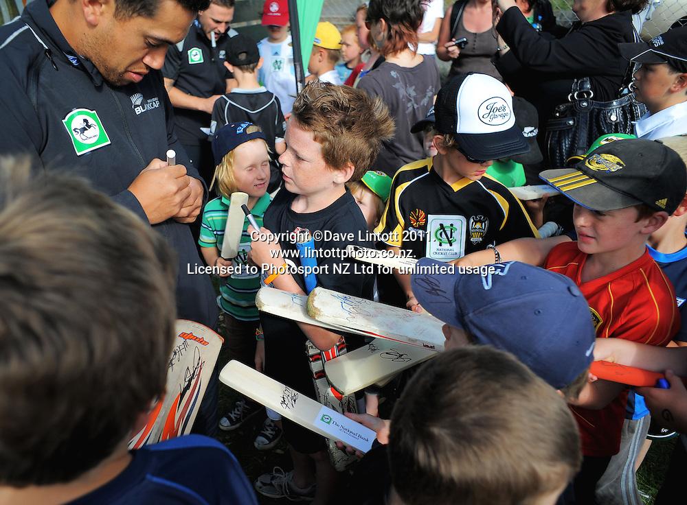 Ross Taylor signs autographs. NCC cricket supercamp at Anderson Park, Wellington, New Zealand on Thursday, 13 January 2011. Photo: Dave Lintott / photosport.co.nz