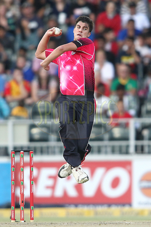 Pat Cummins of the Sydney Sixers sends down a delivery during the Final of the  Karbonn Smart CLT20 South Africa between the Sydney Sixers and the Highveld Lions  held at The Wanderers Stadium in Johannesburg, South Africa on the 28th October 2012..Photo by Shaun Roy/SPORTZPICS/CLT20