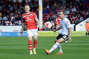 Walsall midfielder Sam Mantom plays the ball past Crewe Alexandra midfielder David Fox during the Sky Bet League 1 match between Walsall and Crewe Alexandra at the Banks's Stadium, Walsall, England on 26 September 2015. Photo by Alan Franklin.