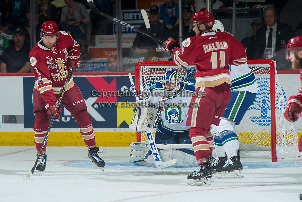 REGINA, SK - MAY 19: Samuel L'Italien #9 of Acadie-Bathurst Titan looks for the pass as Stuart Skinner #74 of Swift Current Broncos defends the net at the Brandt Centre on May 19, 2018 in Regina, Canada. (Photo by Marissa Baecker/CHL Images)