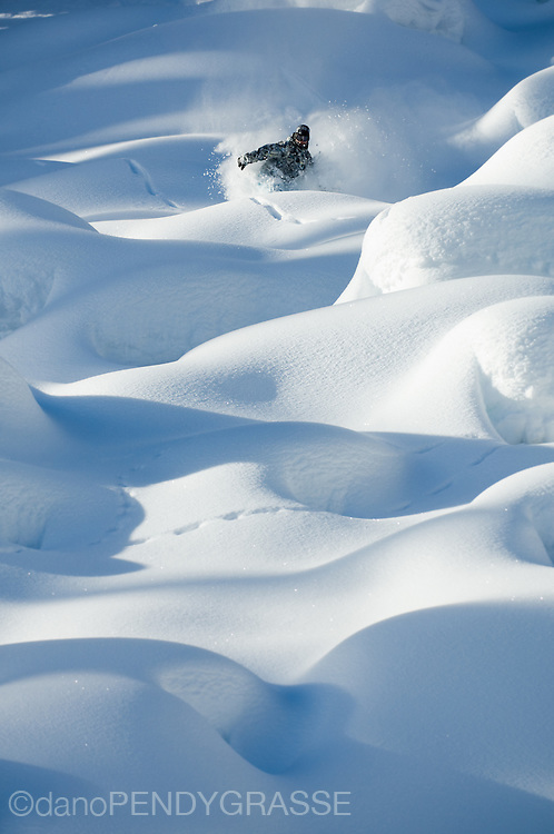 Professional snowboarder Mark Landvik in the Kootenay Mountains of British Columbia, Canada.