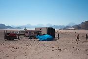 People, vehicles and cliffs at Middle East Tek, Wadi Rum, Jordan, 2008
