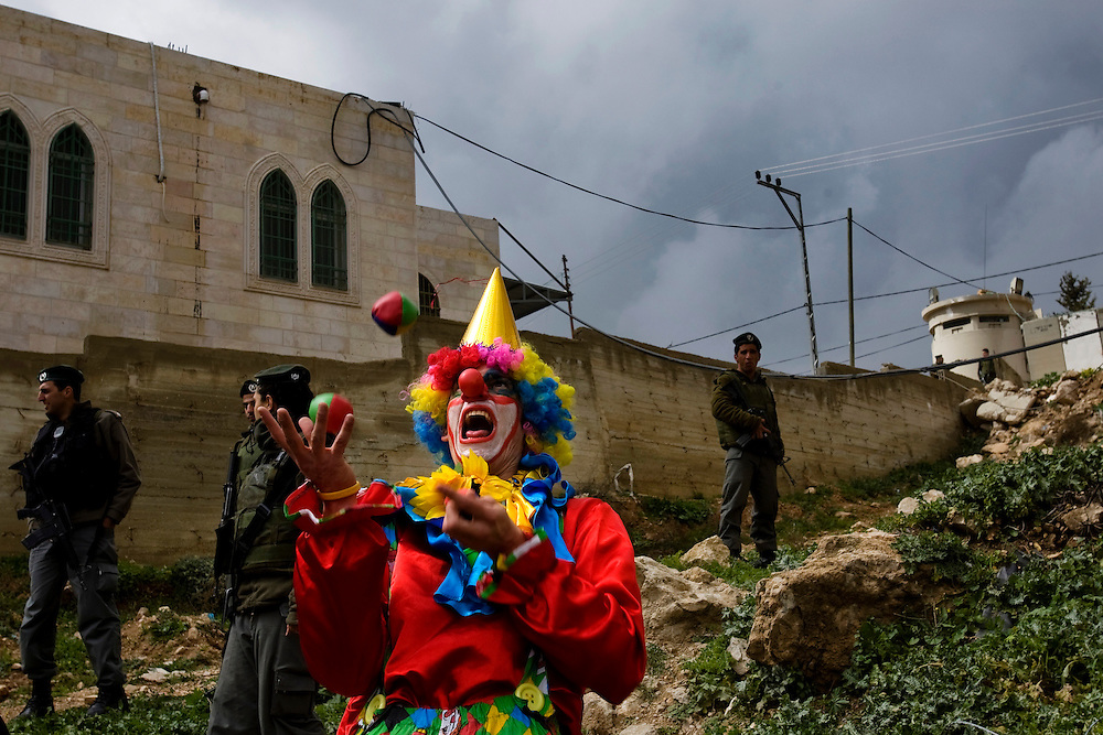 Jewish settlers are dressed in costumes as they participate in the annual parade marking the Jewish holiday of Purim, in the divided West Bank town of Hebron, Sunday, March 28, 2010. The festival of Purim commemorates the rescue of Jews from genocide in ancient Persia. Photo by Olivier Fitoussi