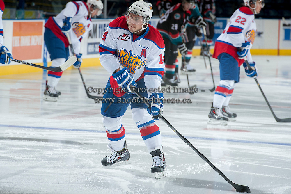 KELOWNA, CANADA - NOVEMBER 9: Riley Kieser #14 of the Edmonton Oil Kings takes a shot during warm up on November 9, 2013 at Prospera Place in Kelowna, British Columbia, Canada.   (Photo by Marissa Baecker/Shoot the Breeze)  ***  Local Caption  ***