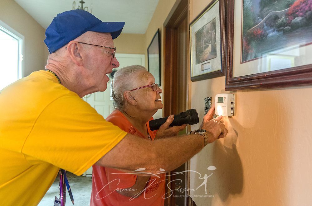Southern Baptist Disaster Relief chaplain Roy Christy, of Northern Hills Baptist Church in Holt, Missouri, talks with homeowner Fay McDowell, of Zoar Baptist Church, as they try to figure out why her air conditioner is not working, Aug. 22, 2016, in Baton Rouge, Louisiana. McDowell is one of thousands of Louisiana residents whose homes were damaged by floods last week. Christy, along with other SBDR volunteers from Missouri, is helping with cleanup and recovery at McDowell's home. (Photo by Carmen K. Sisson/Cloudybright)