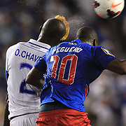 Osman Chávez, Honduras, (left) and Jean-Philippe Peguero, Haiti, challenge for the ball during the Haiti V Honduras CONCACAF Gold Cup group B football match at Red Bull Arena, Harrison, New Jersey. USA. 8th July 2013. Photo Tim Clayton
