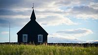 The black church at Búðir. Snæfellsjökull glacier in background. Snæfellsnes Peninsula, West Iceland.