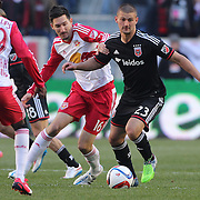 Perry Kitchen, D.C. United, is challenged by Sacha Kljestan, New York Red Bulls, during the New York Red Bulls Vs D.C. United Major League Soccer regular season match at Red Bull Arena, Harrison, New Jersey. USA. 22nd March 2015. Photo Tim Clayton