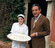 The Vannulo cheese factory in Campania...Tenuta Vannulo..Azienda   Agricola Biologica Antonio Palmieri..Caseificio Vannulo..Dott.Antonio Palmieri an  employee with the mozzarella of bufala ..http://www.vannulo.it/production.html........