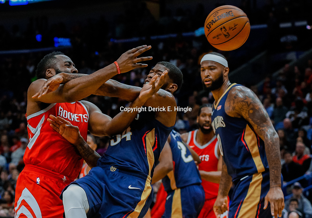 Jan 26, 2018; New Orleans, LA, USA; New Orleans Pelicans guard DeAndre Liggins (34) knocks the ball away from Houston Rockets guard James Harden (13) during the second quarter at the Smoothie King Center. Mandatory Credit: Derick E. Hingle-USA TODAY Sports