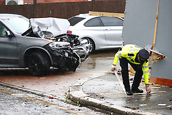 © Licensed to London News Pictures. 14/07/2019. London, UK. Police examine the scene near a crashed BMW X5 car  in Battersea, south west London after a car was driven into a group of people leaving a hotel. Three men have been arrested on suspicion of murder after the incident which took place at 11. 15pm on Saturday night. One man has a broken leg and six other people also sustained minor injuries. Photo credit: Peter Macdiarmid/LNP