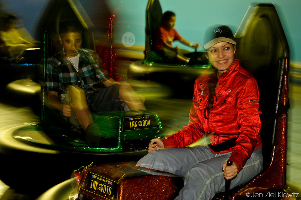 Maria Rosa Alvarez, of Los Angeles California, enjoys a late evening ride on the bumper cars on the Santa Monica Pier, in Santa Monica, California, on April 19, 2009.  Photo by Jen Klewitz