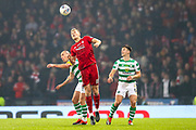 Sam Cosgrove (#16) of Aberdeen wins the header in midfield against Scott Brown (#8) of Celtic during the Betfred Cup Final between Celtic and Aberdeen at Celtic Park, Glasgow, Scotland on 2 December 2018.