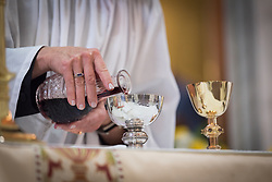 20 April 2019, Jerusalem: Deacon Della Wells pours the wine into the chalice in preparation for Holy Communion, during Easter Sunday service at the Cathedral Church of Saint George the Martyr, Jerusalem.