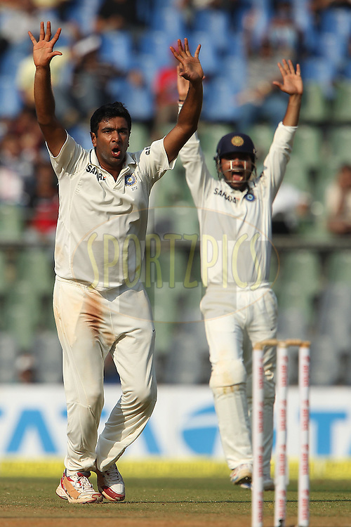 Ravichandran Ashwin of India and Virat Kohli of India appeal for the wicket of Kevin Pietersen of England during day 2 of the 2nd Airtel Test match between India and England held at the Wankhede Stadium in Mumbai, India on the 24th November 2012...Photo by Ron Gaunt/ BCCI/ SPORTZPICS..Use of this image is subject to the terms and conditions as outlined by the BCCI. These terms can be found by following this link:..http://www.sportzpics.co.za/image/I0000SoRagM2cIEc