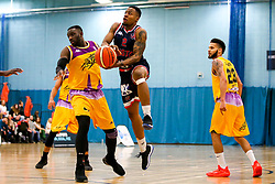 Panos Mayindombe of Bristol Flyers takes on Dzaflo Larkai of London Lions - Photo mandatory by-line: Robbie Stephenson/JMP - 10/04/2019 - BASKETBALL - UEL Sports Dock - London, England - London Lions v Bristol Flyers - British Basketball League Championship