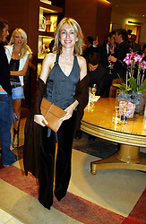 SAHAR HASHEMI at a party hosted by Burberry to launch their special collection in aid of Breakthrough Breast Cancer, held at 21-23 New Bond Street, London W1 on 5th October 2004.<br /><br />NON EXCLUSIVE - WORLD RIGHTS